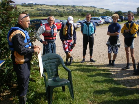 The competitors receiving the Race Officer's briefing