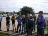 The competitors receiving the Race Officer\'s briefing